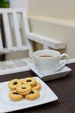Galleta con la taza de cofee Imagenes de archivo