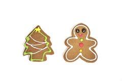 Galleta del hombre de pan de jengibre y del árbol de navidad Fotos de archivo libres de regalías
