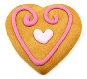 Galleta en forma de corazón con un decoratio que hiela rosado Imagen de archivo libre de regalías