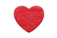 Galleta roja de la dimensión de una variable del corazón en el fondo blanco Imagenes de archivo
