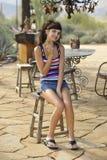 Galleta triguena joven de la consumición Foto de archivo libre de regalías
