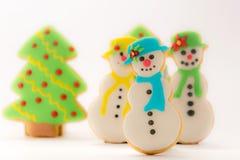 Galletas, árboles de navidad y muñeco de nieve del pan de jengibre de la Navidad Fotos de archivo