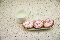 Galletas adornadas, leche Fotografía de archivo libre de regalías