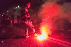 Galletas ardientes del humo de la protesta Imagen de archivo