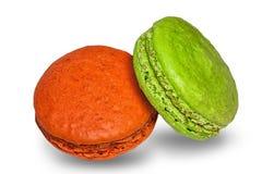 Galletas coloreadas pistacho y naranja de los macarrones Fotografía de archivo libre de regalías
