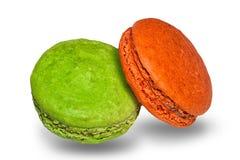 Galletas coloreadas pistacho y naranja de los macarrones Foto de archivo