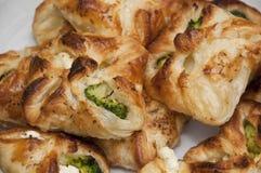 Galletas con bróculi y el queso blanco Foto de archivo