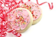 Galletas de azúcar heladas color de rosa del partido Imagen de archivo libre de regalías