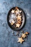 Galletas de azúcar de la forma de la estrella de la Navidad Imagenes de archivo