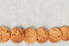 Galletas de harina de avena en la textura del lino Fotos de archivo