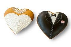 Galletas de la boda en el fondo blanco Fotografía de archivo libre de regalías