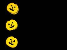 Galletas de la calabaza de Halloween en un fondo negro Imágenes de archivo libres de regalías