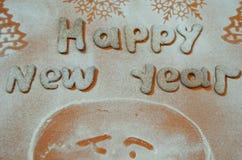 Galletas del Año Nuevo con el azúcar en polvo debajo Imagen de archivo libre de regalías