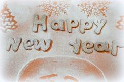 Galletas del Año Nuevo con el azúcar en polvo debajo Imágenes de archivo libres de regalías