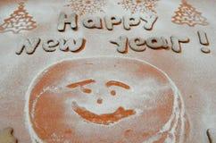Galletas del Año Nuevo con el azúcar en polvo debajo Fotografía de archivo