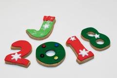 Galletas 2018 del Año Nuevo de la Navidad en el fondo blanco Fotografía de archivo libre de regalías
