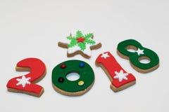 Galletas 2018 del Año Nuevo de la Navidad en el fondo blanco Imagenes de archivo