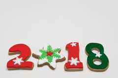 Galletas 2018 del Año Nuevo de la Navidad en el fondo blanco aislado Imagenes de archivo