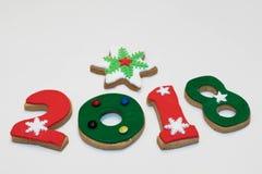 Galletas 2018 del Año Nuevo de la Navidad en el fondo blanco aislado Foto de archivo libre de regalías