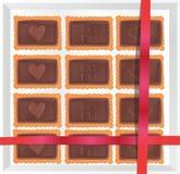 Galletas del chocolate en una caja con una nota Fotos de archivo