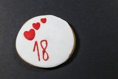 Galletas del cumpleaños por 18 años Foto de archivo