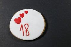 Galletas del cumpleaños por 18 años Imagen de archivo libre de regalías