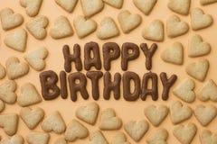 Galletas del feliz cumpleaños y del corazón Fotografía de archivo libre de regalías