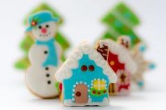 Galletas del pan de jengibre de la Navidad, casas de la Navidad del pan de jengibre y muñeco de nieve Imagen de archivo