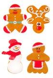 Galletas del pan de jengibre de la Navidad en la forma de ciervos, de un pequeño hombre y de dulces hechos en casa tradicionales  Imagen de archivo