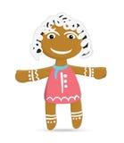Galletas divertidas del jengibre de la muchacha de la arena el día de la Navidad Imagenes de archivo