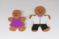 galletas en un fondo, un muchacho y una muchacha ligeros fotos de archivo libres de regalías
