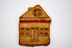 Galletas maravillosas y deliciosas con la mermelada bajo la forma de casa de un piso fotos de archivo libres de regalías