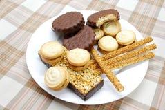 galletas, postres y palillos Fotografía de archivo libre de regalías