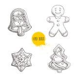 Galletas tradicionales dibujadas mano de la Navidad del bosquejo fijadas Mano Bell hombres de pan de jengibre, copo de nieve y ár Imágenes de archivo libres de regalías