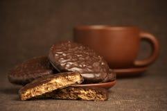 Galletas y café del chocolate Imágenes de archivo libres de regalías