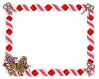 Galletas y caramelo de la frontera de la Navidad Fotos de archivo