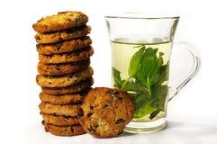 Galletas y té de la menta Fotografía de archivo libre de regalías