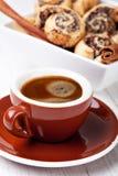 Galletas y taza de café Imagen de archivo