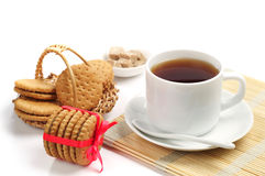 Galletas y taza de té Imagen de archivo
