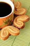 Galletas y una taza de café Imagen de archivo