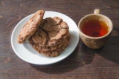 Galletas y una taza de té Fotografía de archivo