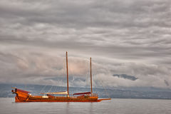 Galley on Lake Geneva. In a cloudy day Stock Photos