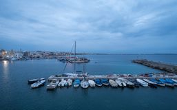 Photograph of colourful fishing boats in the harbour in the town of Gallipoli in the Salento Peninsula, Puglia, Southern Italy. Gallii Italy. Photograph of stock image