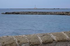 Photograph of lighthouse on the coastline in the town of Gallipoli in the Salento Peninsula, Puglia, Southern Italy. Gallii Italy. Photograph of lighthouse on stock photo