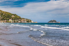 Gallinara Island and Town of Alassio in Italy Royalty Free Stock Photo