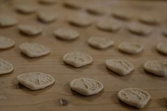 Close up of freshly made orecchiette, ear shaped pasta on a wooden table, traditional to the Puglia region of Italy. Gallipoli, Italy. Close up of freshly made royalty free stock images