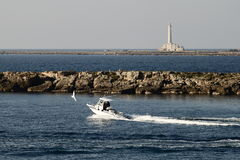 Gallipoli-Italy  coast and boat with island and lighthouse Stock Photo