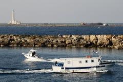 Gallipoli-Italy coast with island and lighthouse. Coast with island and lighthouse stock images