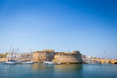 Gallipoli, Italy - historical centre view from the sea. The harbour and the old walls of Gallipoli, Puglia Region - South Italy Royalty Free Stock Photo