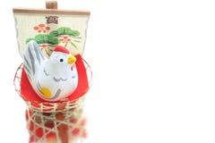 Gallo del Año Nuevo y nave de tesoro en el agua Fotos de archivo libres de regalías